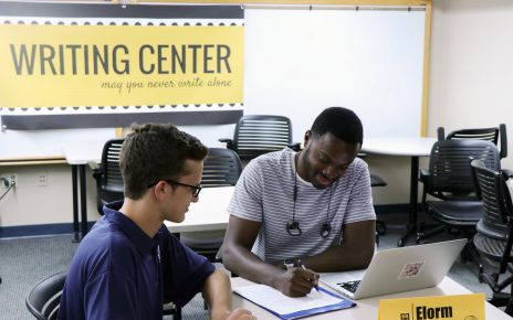 Student working with Writing Center tutor